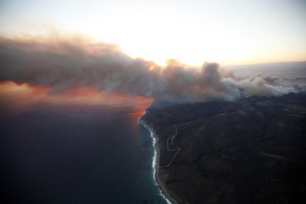 Aerial view of Springs fire as it burns through Sycamore Canyon at sunset on Thursday.
