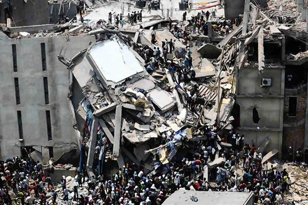 People rescue garment workers trapped under rubble at the Rana Plaza building after it collapsed, in Savar.