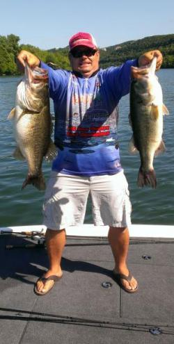 Donnie O'Neal with the 11.8-pound and 7.8-pound bass he caught on a YUMbrella Flash Mob Jr. at Lake Austin in Texas.