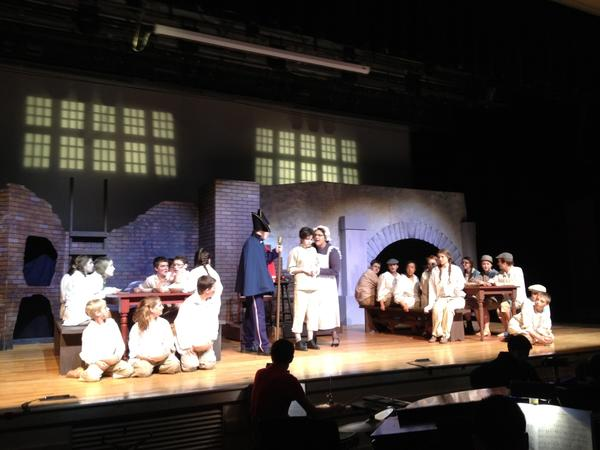 "Members of the cast of Avon High School's production of ""Oliver"" go through a scene during a dress rehearsal for the show."