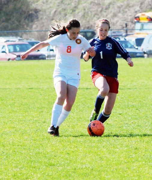 Harbor Springs Anna DeCamp (left) and Boyne Citys Margaret Durbin vie for a loose ball during a Lake Michigan Conference match Thursday at Ottawa Field in Harbor Springs.
