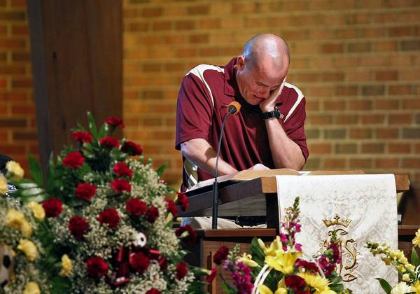 Poquoson High School varsity soccer coach Charlie Sneddon begins to cry while speaking about Brandon Love during Thursday's Celebration of Life service for Brandon Love. Sixteen-year-old Love died unexpectedly on Saturday, April 27.