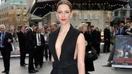 "Rebecca Hall loves designer labels. While promoting her new film ""Iron Man 3,""  Hall showed off her expensive tastes on the red carpet."