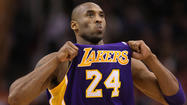 Los Angeles Laker Kobe Bryant is trying to stop his mother from selling off memorabilia from earlier in his career.