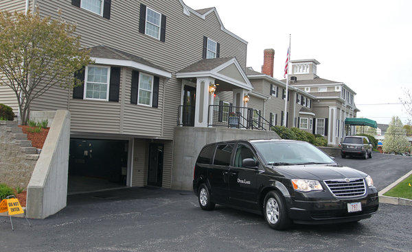 A vehicle believed to be carrying the body of Boston Marathon bombing suspect Tamerlan Tsarnaev backs into an underground garage at the Dyer-Lake Funeral Home in North Attleborough, Mass. The body has been moved to a different funeral home.