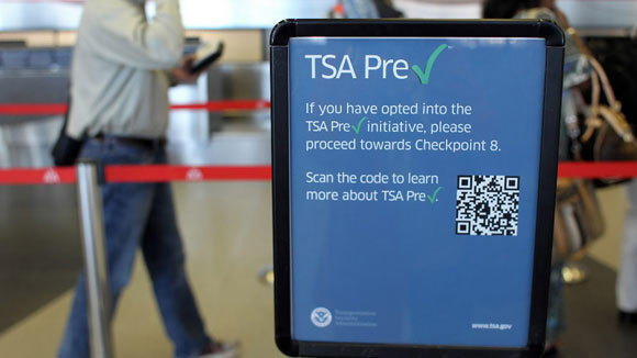 Signs direct American Airlines passengers to the TSA precheck line at O'Hare International Airport last August.