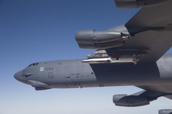 A B-52 bomber carries the X-51A WaveRider out to for its launch test.