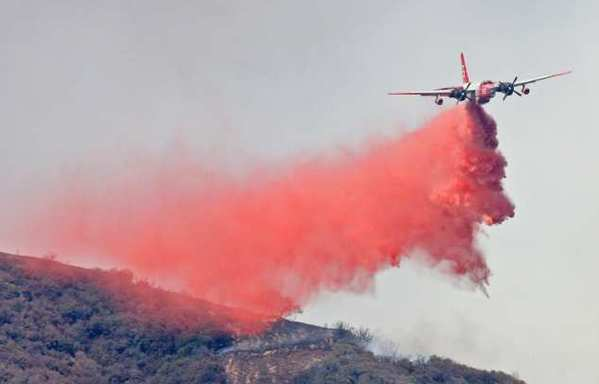 An air tanker drops a load of foscheck fire retardant on a brush fire in Angeles National Forest above La Canada in 2009.
