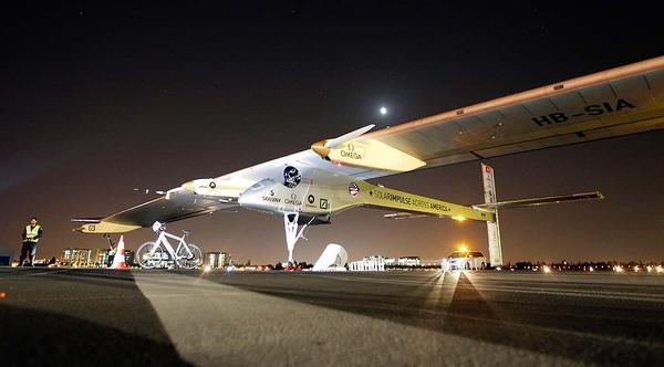 The Solar Impulse sits on the tarmac before takeoff from Moffett Field at NASA Ames Research Center in Mountain View, Calif.