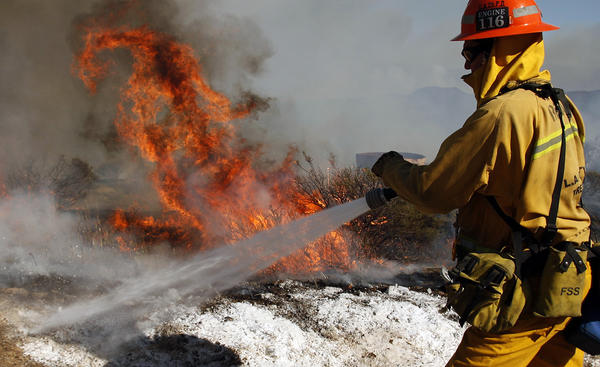 Firefighter battles Springs Fire
