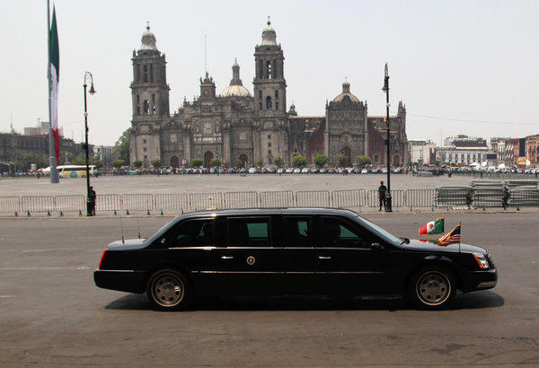 "Obama's presidential limousine, nicknamed ""The Beast,"" is driven past the Metropolitan Cathedral in Mexico City on Thursday."