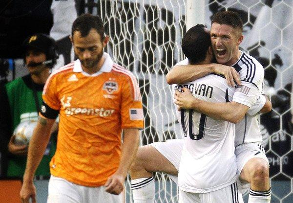 Galaxy forward Robbie Keane leaps into Landon Donovan's arms as the Galaxy finish off a 3-1 win over the Houston Dynamo in the MLS Cup last season.