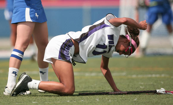 Timber Creek's Lauren Sherry pounds her fist into the ground out of frustration during their loss to  St. Johns Bartram Trail in the FHSAA girls lacrosse state semifinal at West Orange High School in Orlando, Fla. Friday, May 3, 2013. (Gary W. Green/Orlando Sentinel)