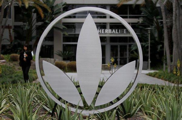 Herbalife denies hedge fund manager's allegations that it is a pyramid scheme.