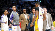 "A compilation of all of the Lakers' postmortem material recently published in your paper would read something akin to ""War and Peace."" Hey, they had a rough season, they have some decisions to make and the future is uncertain. Enough said."