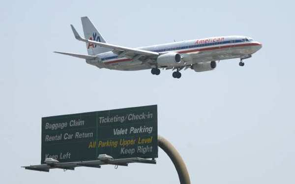 An American Airlines flight prepares to land at John Wayne Airport in this file photo.