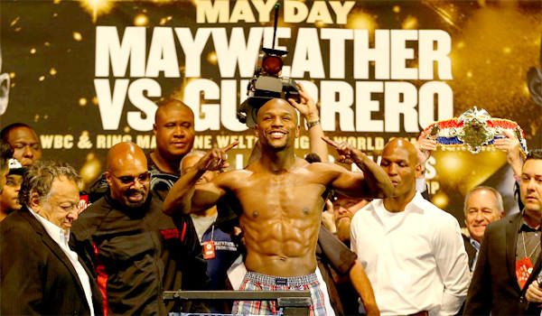 Floyd Mayweather Jr. smiles Friday during the weigh-in before his fight Saturday against Robert Guerrero in Las Vegas.