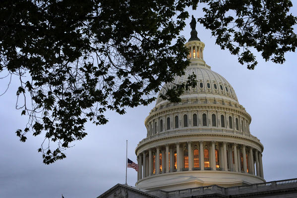 A U.S. flag flies at half staff on the U.S. Capitol April 15, 2013 on Capitol Hill in Washington, DC.