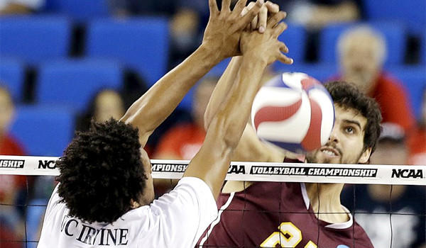 UC Irvine's Chris Austin defends as Loyola Chicago's Nicholas Olson hits the ball in the second set of the Anteaters' sweep of the Ramblers, 26-24, 25-18, 29-27.