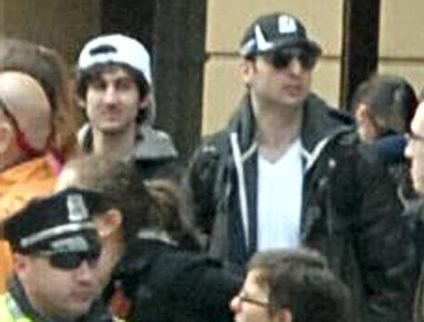 The suspect in the white cap has been named as Dzhokar Tsarnaev, according to reports. The other suspect, Dzhokar Tsarnaev's brother, in the Boston Marathon bombings has been killed.