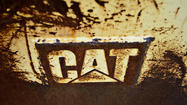 Earth-moving equipment maker Caterpillar Inc. said Friday will lay off an additional 300 employees in Decatur, Ill., by July.