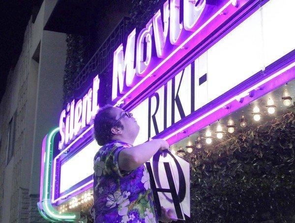 "Mark Ayala puts up the movie title on the marquee before the midnight showing of the movie ""Riki-Oh"" at the Cinefamily on Fairfax Avenue in Los Angeles on April 26, 2013."