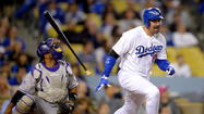 The Dodgers scratched first baseman Adrian Gonzalez from their lineup Friday after he complained of neck stiffness.