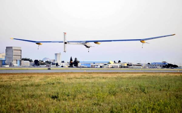 The Solar Impulse, a solar-powered airplane, takes off from Moffett Field in Mountain View, Calif., on the first leg of its flight across the United States.