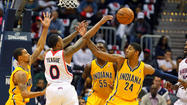 ATLANTA - Roy Hibbert gathered his Indiana Pacers teammates as the Atlanta Hawks, listless and ineffective for three quarters, mobilized for a fourth-quarter run to cut the Pacers lead from 19 points to 5.