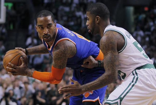 The Knicks' J.R. Smith drives past the Celtics' Terrence Williams during the first half.