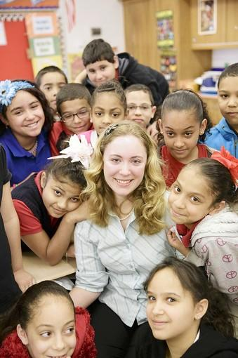 Diana Livingston, a student teacher at 16th and Haak Street Elementary School in Reading, is surrounded by her students. Diana has cerebral palsy, and will be graduating from Penn State on May 4th.