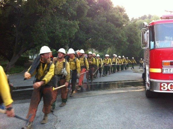 Firefighters head out to battle the Springs fire in Ventura County's Hidden Valley.