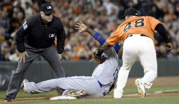 Dodgers shortstop Hanley Ramirez suffered an injury to his left hamstring after trying to turn a base hit single into a triple during the opening game of a series with the San Francisco Giants on Friday.