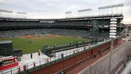 "The <a href=""http://chicagotribune.com/sports/baseball/cubs"">Chicago Cubs</a> provided detailed descriptions of the signs the team would like to place outside Wrigley Field in its zoning application, but the precise locations of large outfield signs were not included in the paperwork filed with City Hall."