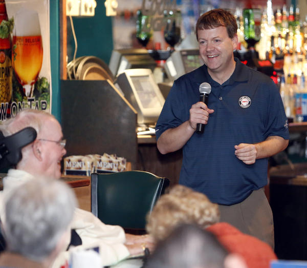 ESPN Baseball Tonight analyst Buster Olney, right, speaks to a group of NSU Wolves Club members Friday at Lager's Inn. Olney will give the commencement address today at NSU's graduation ceremonies. photo by john davis taken 5/3/2013