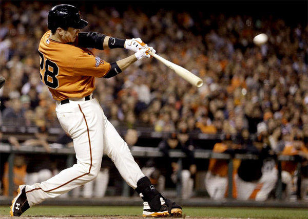 San Francisco Giants' Buster Posey hits an RBI double in the sixth inning.