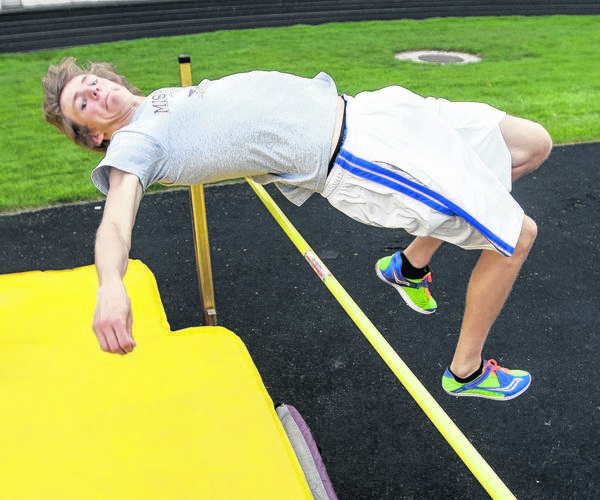 Mishawaka's Robert Lambert practices the high jump at 5-foot-10 during track practice on Thursday at Mishawaka High School in Mishawaka. Lambert recently cleared 6-foot-8 to break a school record that stood for more than 50 years.