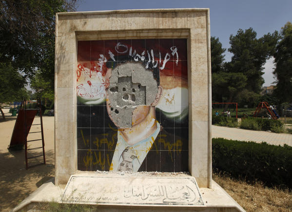 A vandalized mosaic picture of Syria's President Bashar al-Assad is pictured in Raqqa province, east Syria.