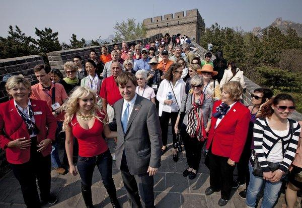 Christopher Cox, grandson of President Richard Nixon, center, with his wife Andrea Catsimatidis and the U.S. delegation tour the Great Wall of China at Badaling on Saturday.