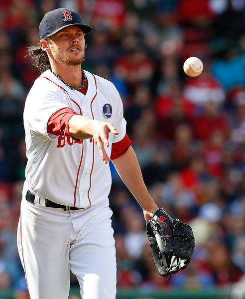Red Sox starter Clay Buchholz throws to first for the out in the seventh inning.