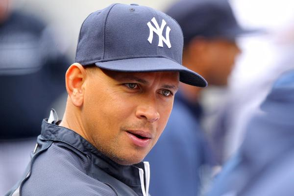 Injured Yankees third baseman Alex Rodriguez sits in the dugout.
