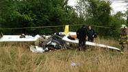 After attempting to land several times, an experimental plane crashed Saturday in Suffolk, killing the pilot and the passenger, according to police.
