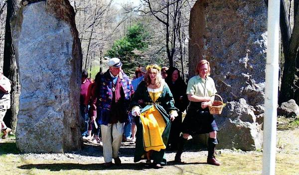 Bill Cohea, Columcille founder, with the May Queen and Bard at Thor's Gate during a Bealtainne Celebration at Columcille Megalith Park near Bangor.