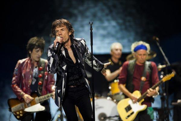 Ronnie Wood, left, Mick Jagger, Charlie Watts and Keith Richards perform at Staples Center in Los Angeles on Friday as part of the Rolling Stones' 50 and Counting Tour.