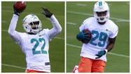 DAVIE — Dolphins rookie cornerbacks Will Davis and Jamar Taylor were teammates for the Senior Bowl in January, but putting on those uniforms didn't compare to putting on their Dolphins practice gear Friday for the opening day of Miami's three-day rookie minicamp.