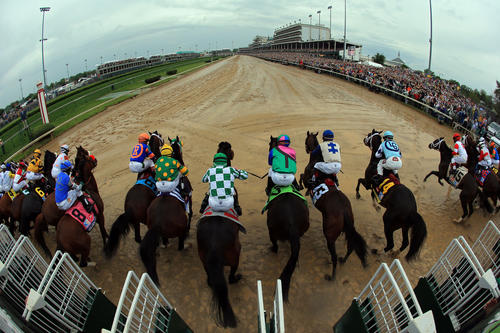 The field comes out of the gate to start the 139th running of the Kentucky Derby at Churchill Downs.