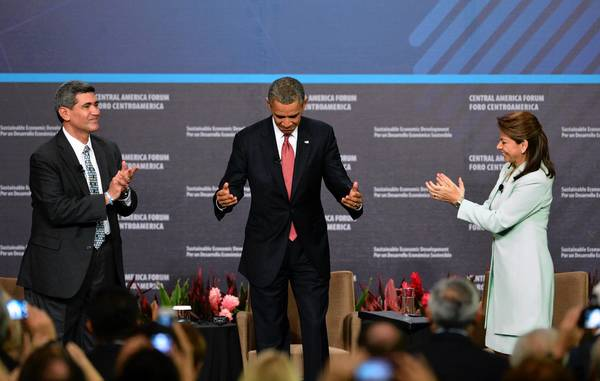 Costa Rican President Laura Chinchilla and INCAE University President Arturo Condo applaud President Obama after his speech during the Inclusive Economic Growth and Development forum in San Jose, Costa Rica.