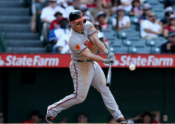 Baltimore Orioles' Steve Pearce drives in the go-ahead run in the 10th inning.