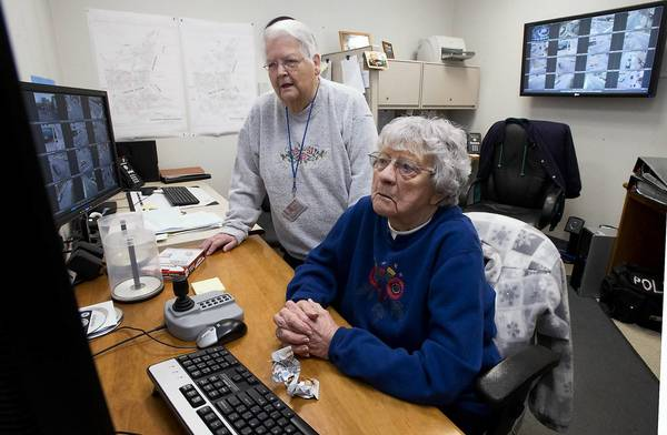 Volunteers Lee Wisner-Greger (left) and Louise Ward monitor Easton's crime cameras because the Police Department doesn't have the money to hire staff for the job.