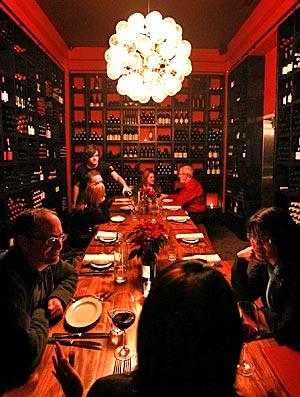 Cube's new wine room has a communal table for dining.